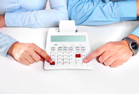 Hands of business person working with calculator Stock Photo - 16417368