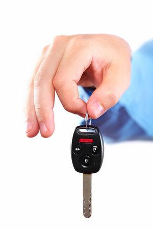 Hand with a car key