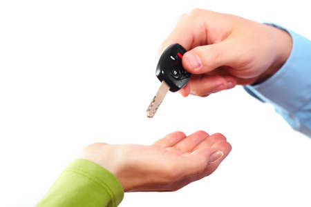 Hand with a car key  Stock Photo - 16417360