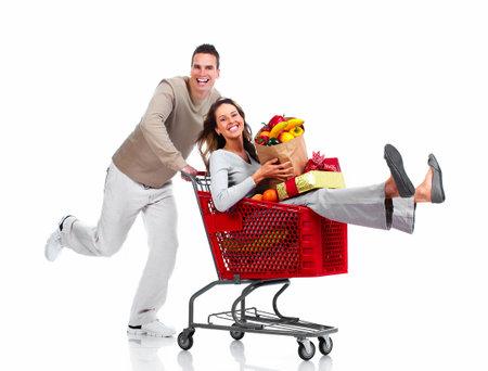 woman shopping cart: Santa Christmas couple with a gift