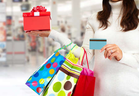 Christmas shopping woman with gift  photo