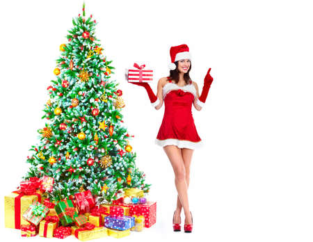 Beautiful young Christmas girl with a gift Stock Photo - 16619523