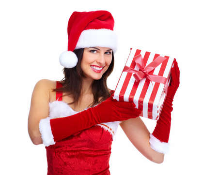 Beautiful young Christmas girl with a gift  Stock Photo - 16619419