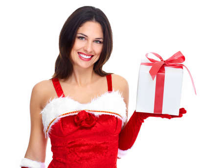 Beautiful young Christmas girl with a gift Stock Photo - 16619430