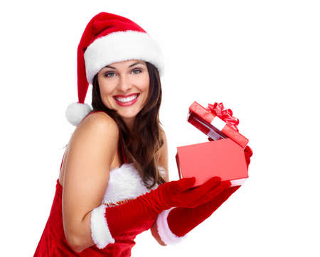 Beautiful young Christmas girl with a gift  Stock Photo - 16619395