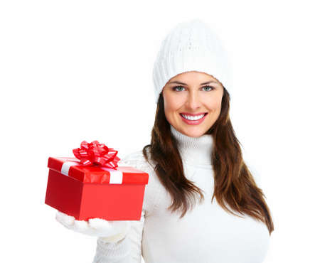 Beautiful young Christmas girl with gift  Stock Photo - 16619425