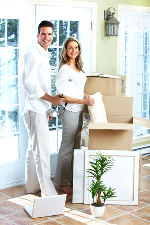 Happy couple moving in a new house  Stock Photo - 16619516