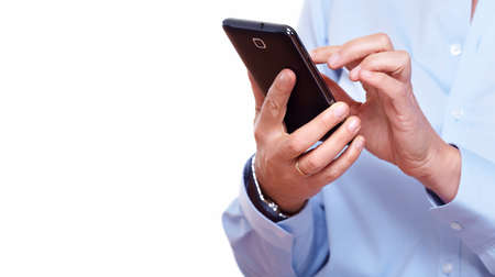 ecran: Hands of woman with a smartphone. Isolated on white. Stock Photo