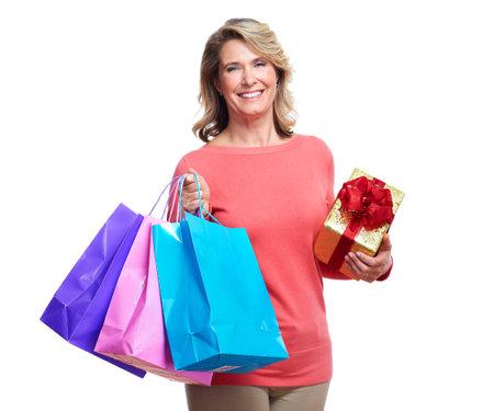 mujeres maduras: Superior de la mujer con bolsas de la compra