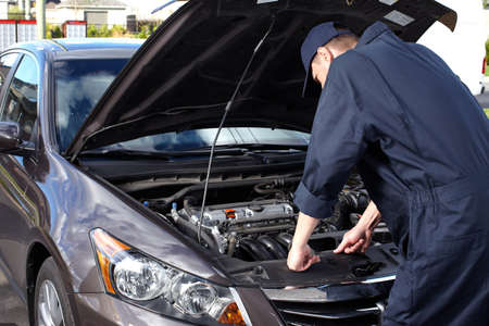 Car mechanic working in auto repair service Stock Photo - 16619522