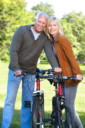 Happy senior couple cyclist  Stock Photo - 16619525