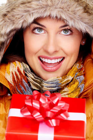 Beautiful young Christmas girl with a present Stock Photo - 16607040