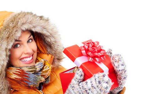 Beautiful young Christmas girl with a present Stock Photo - 16607021