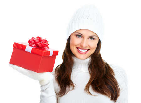 winter fashion: Beautiful young Christmas girl with gift