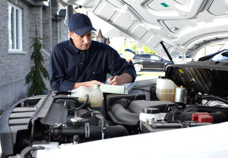 auto repair: Car mechanic working in auto repair service