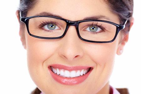 optometrist: Beautiful young woman wearing glasses portrait
