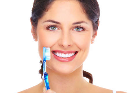 Beautiful woman smile with a toothbrush  Stock Photo - 16643011