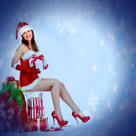 Santa helper Christmas girl with a presents  Stock Photo - 16643007