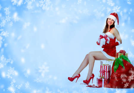 Santa helper Christmas girl with a presents Stock Photo - 16643019