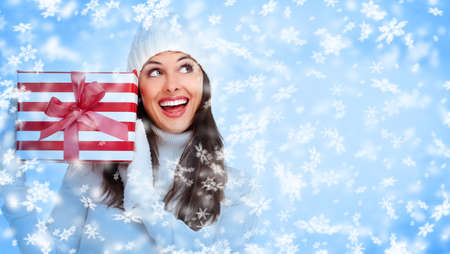 Santa helper Christmas girl with a gift  Stock Photo - 16643016