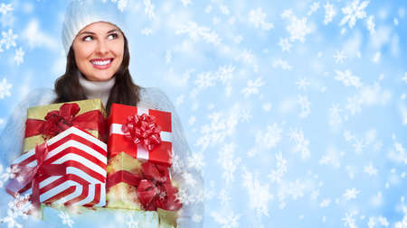 Santa helper Christmas girl with a gift Stock Photo - 16643028