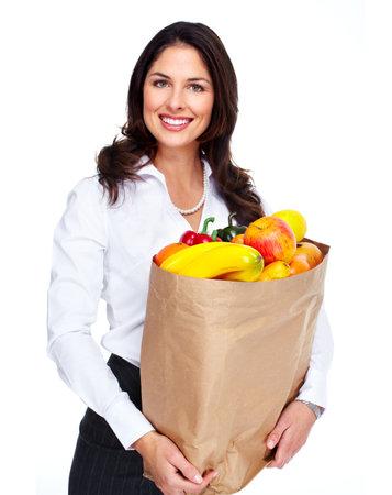 Jeune femme avec un sac d'�picerie
