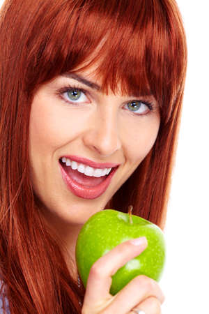 Young beautiful woman with apple  photo