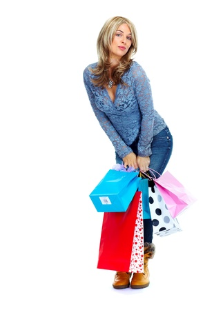 Shopping woman with a bags isolated on white background. Stock Photo - 16959609