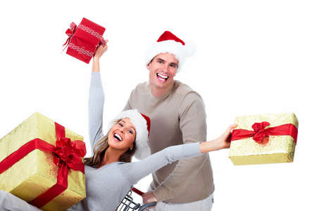 Happy young Christmas couple with  gifts isolated on white background. Stock Photo - 16959333