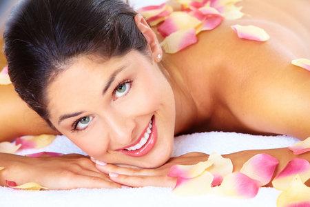 Young beautiful woman getting massage in spa salon. Stock Photo - 16959021