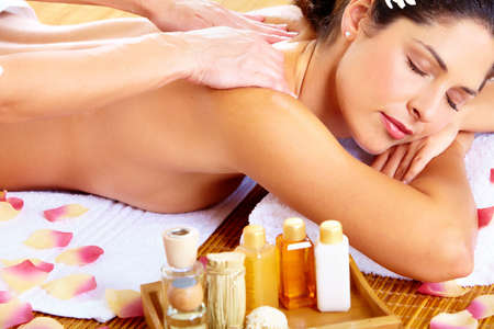 Young beautiful woman getting massage in spa salon. Stock Photo - 16958960