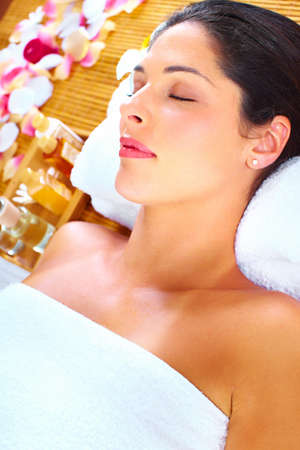 Young beautiful woman getting massage in spa salon. Stock Photo - 16959024