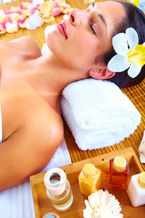 Young beautiful woman getting massage in spa salon. Stock Photo - 16959025