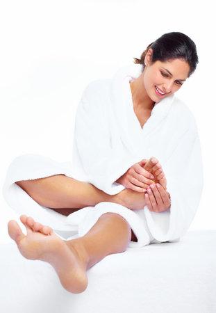 Woman enjoying a feet massage in a spa salon. Stock Photo