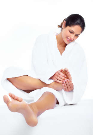 Woman enjoying a feet massage in a spa salon. Stock Photo - 16958988