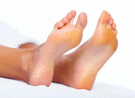 Woman enjoying a feet massage in a spa salon. Stock Photo - 18892885