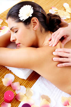Young beautiful woman getting massage in spa salon. Stock Photo - 16959026