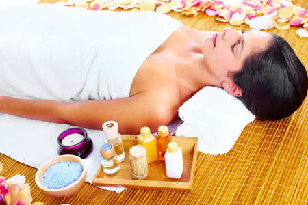Young beautiful woman getting massage in spa salon. Stock Photo - 16959028
