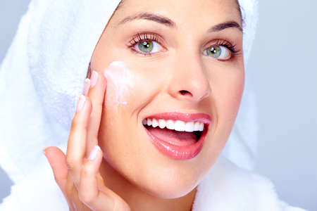 woman face cream: Face of beautiful woman. Spa massage concept background.