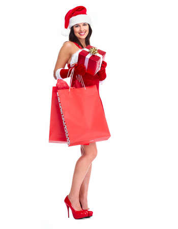 Beautiful Santa helper Christmas girl with shopping bags. isolated on white background. photo