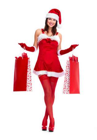 Beautiful Santa helper Christmas girl with shopping bags. isolated on white background. Stock Photo - 16958983