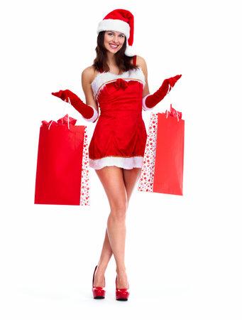 santa helper: Beautiful Santa helper Christmas girl with shopping bags. isolated on white background.