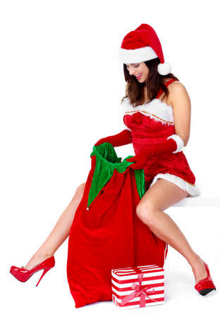 Beautiful Santa helper christmas girl with  gifts isolated on white background. Stock Photo - 16959810