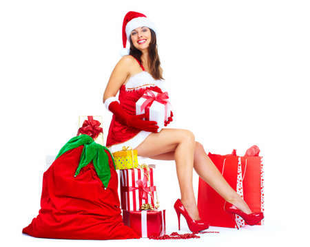 Beautiful Santa helper christmas girl with  gifts isolated on white background. Stock Photo - 16959619
