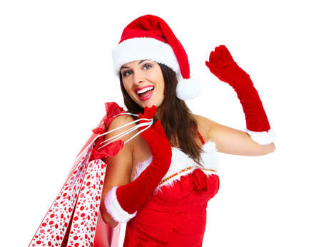 Christmas santa Shopping woman with bags isolated on white background. Stock Photo - 16958996