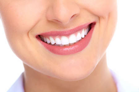 mouth close up: Beautiful young woman smile. Dental health.