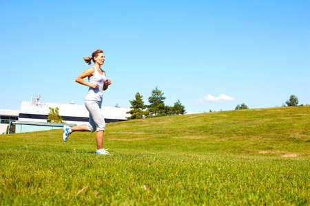 Young woman jogging in the park. Health and fitness. photo