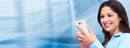telecomm: Business woman with a smartphone