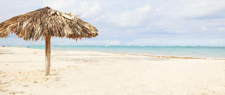 Beach umbrella on exotic caribbean plage  Stock Photo - 17249857