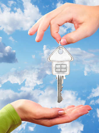 Hand with a home key  Stock Photo - 17315872